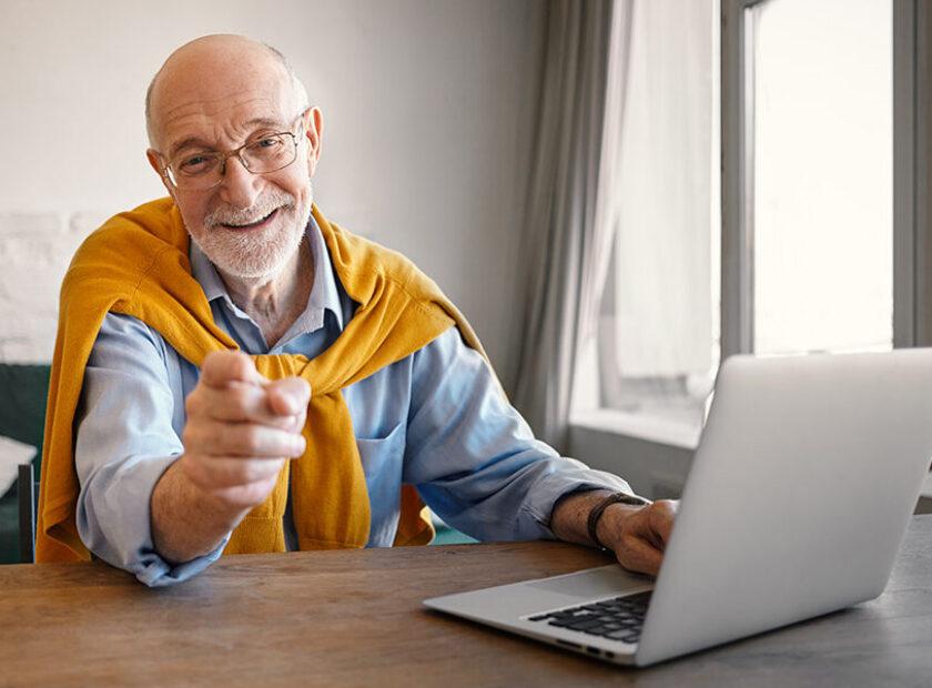 Fashionable friendly elderly male recruiter wearing rectangular