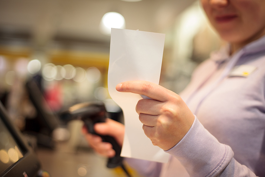 Young woman hands waiting for a prints of invoice for a customer