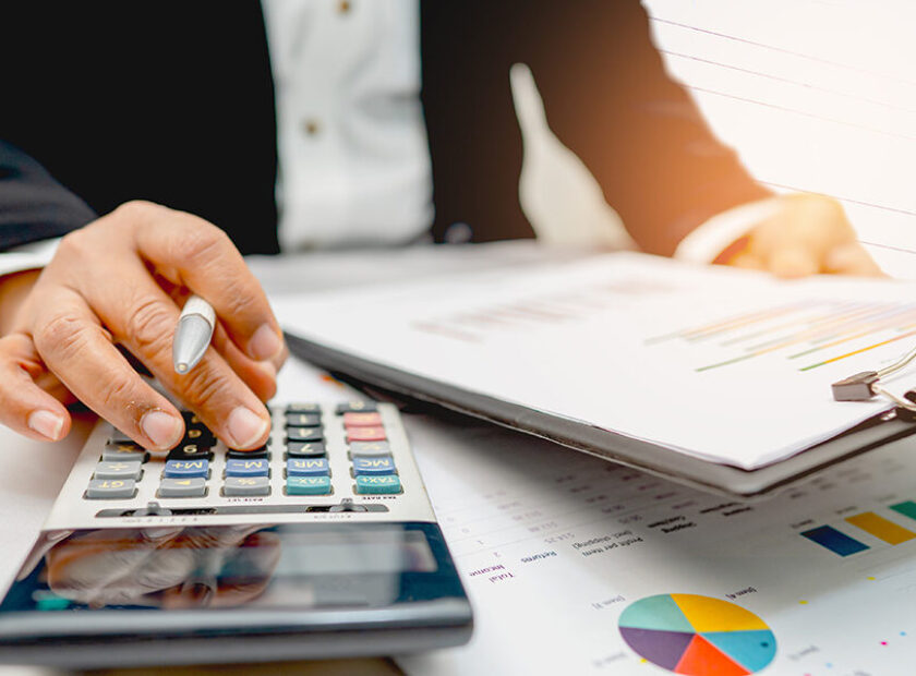 Asian accountant working and analyzing financial reports project