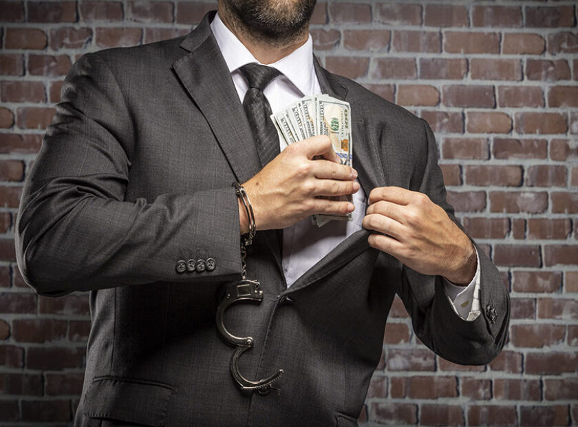 Corrupt man holding bills of money