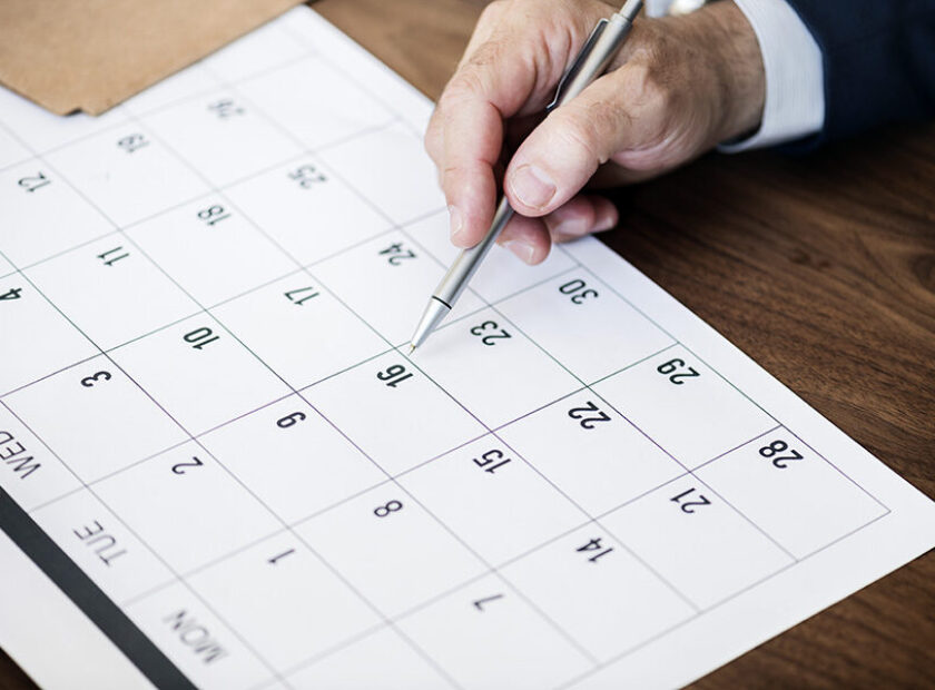 Businessman marking on calendar for an appointment