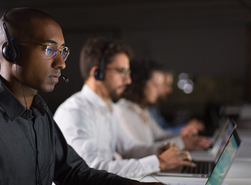 Concentrated African American call center operator working